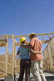 Couple Standing At An Unfinished Housing Construction Stock Image