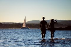 Couple Standing on Water Royalty Free Stock Images
