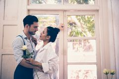 Couple standing by the window. In the morning Stock Image