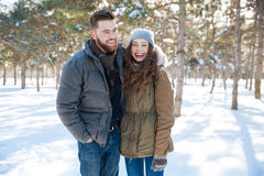 Couple standing in winter park Stock Photography