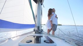 Couple standing on a yacht.  stock footage