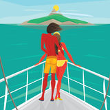 Couple standing on a yacht and admire the island Royalty Free Stock Images