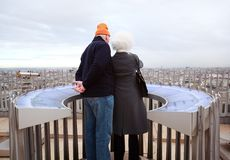 Couple stands on Arc de Triomphe Royalty Free Stock Photography