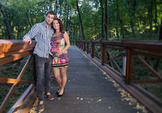 Couple stands on bridge. Royalty Free Stock Photos