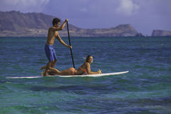 Couple on standup paddle board Stock Photos