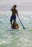 Couple on standup paddle board Royalty Free Stock Photos