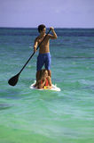 Couple on standup paddle board Stock Photo