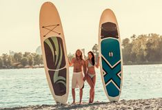 Couple standup paddleboarding stock images