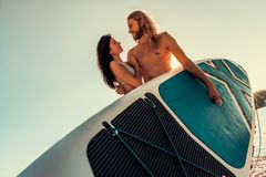 Couple standup paddleboarding royalty free stock photography
