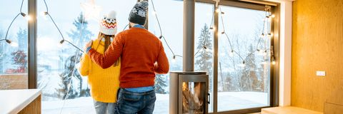 Free Couple Stannding Together In The Modern House In The Mountains During Winter Time Royalty Free Stock Photography - 135108417