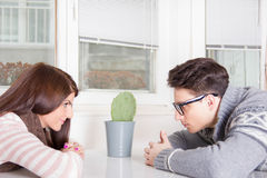 Couple staring at each other across the table. At home Royalty Free Stock Photography