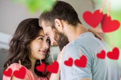Couple staring at each other with hanging hearts Stock Photo