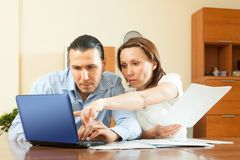 Couple staring financial documents  in home Royalty Free Stock Image