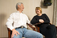 Couple Staring and Smiling - horizontal royalty free stock photos