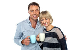 Couple starting their day with a cup of coffee Royalty Free Stock Images