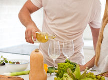 Couple starting to drink a white wine at home Royalty Free Stock Photography