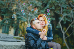 Couple starts soap bubbles Royalty Free Stock Image