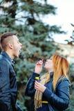 Couple starts soap bubbles Stock Images
