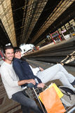 Couple on station platform Royalty Free Stock Image