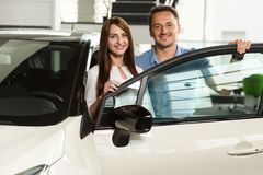 Couple stay behinde the car door. royalty free stock photography