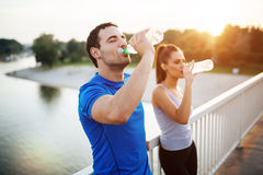 Couple staying hydrated Stock Image