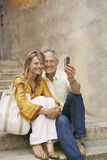 Couple On Steps Photographing Selves Stock Image