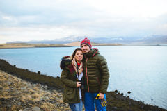 Couple at Stone Lake Shore. Couple standing at stone lake shore in Iceland Stock Image