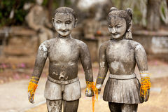 Couple stone sculpture. Stone religious sculpture of couple holding hands, thailand Royalty Free Stock Photos