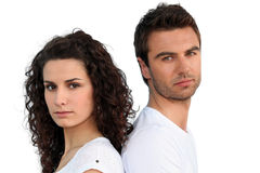 Couple stood back to back Royalty Free Stock Photos