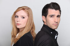 Couple stood back to back Royalty Free Stock Images