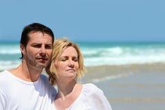 Couple stood on a beach Royalty Free Stock Photos