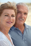 Couple stood on beach Royalty Free Stock Image