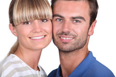 Couple stood cheek to cheek Royalty Free Stock Photography