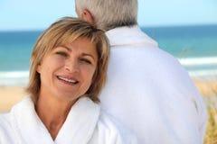 Couple stood by coast Stock Image