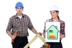 Couple stood with energy rating Stock Photo