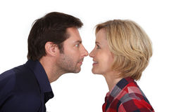 Couple stood face-to-face. Couple stood with noses touching Stock Photography