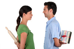 Couple stood facing each other Stock Photo