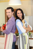 Couple stood in the kitchen Stock Images