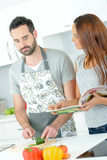 Couple stood in kitchen Stock Images