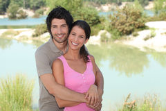 Couple stood by lake Royalty Free Stock Photos