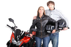 Couple stood with motorcycle Stock Photo