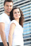 Couple stood by office block. Couple stood in front of office block royalty free stock photography