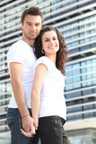 Couple stood by office building Stock Image