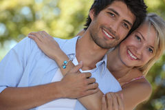 Couple stood in a park. Couple stood close to each other in park Stock Images