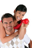 Couple stood with plastic heart Stock Photos