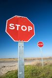 Couple of stop traffic signs Stock Photos