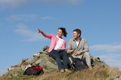 Couple Stopping For Lunch On Countryside Walk Stock Photos