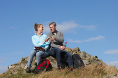 Couple Stopping For Lunch On Countryside Walk Royalty Free Stock Photography