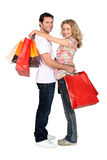 Couple with store bags Stock Photo