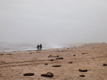 Couple On Stormy Beach stock photography